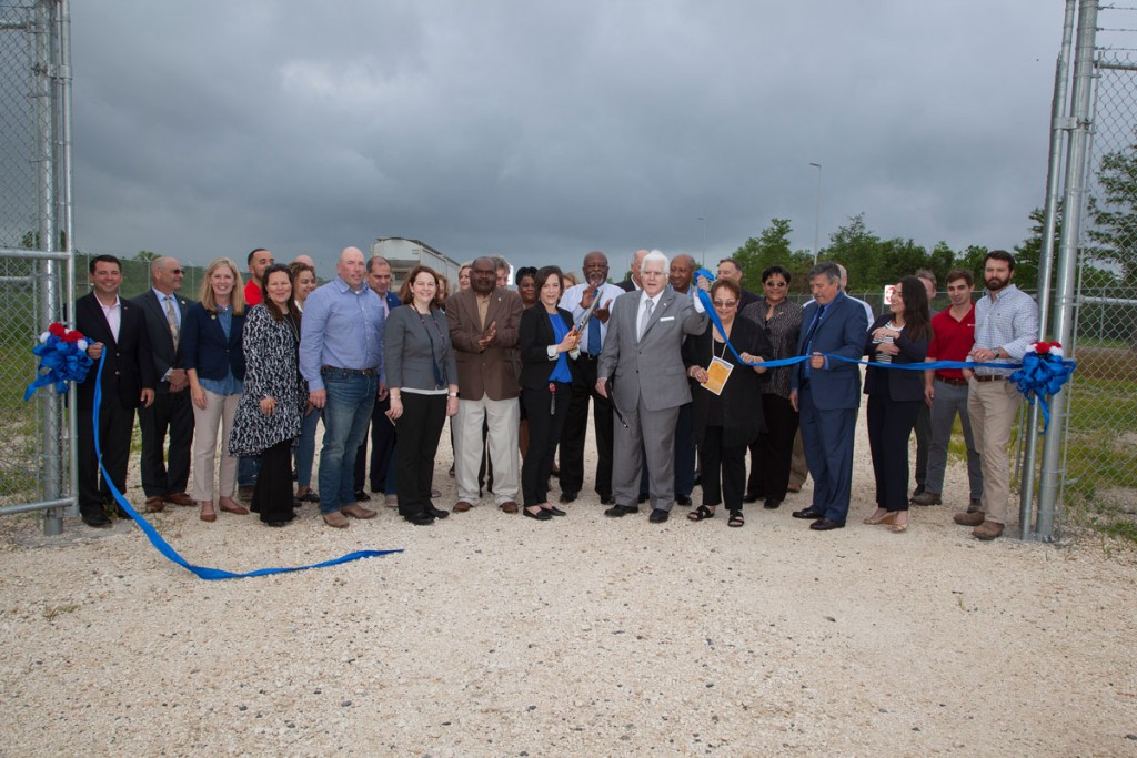 The ribbon-cutting led by Dow Chemical's Jackie Yaworski (center-left) and Port of South Louisiana's Paul Aucoin (center-right), joined by members of Dow's team; representatives from Barriere Construction and AECOM; state and regional officials; and Port of South Louisiana commissioners and staff