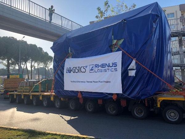 A 200 metric-ton stator passing under a bridge in Turkey.