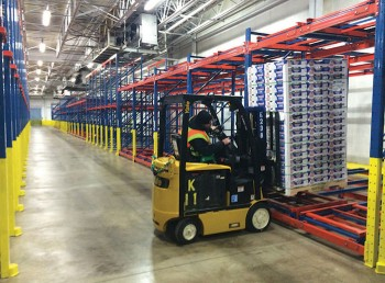 """A worker loads the first pallet of fresh Chilean table grapes into the new, state-of-the-art """"Box 5"""" refrigerated storage facility at the Gloucester Marine Terminal in Gloucester City, NJ. The renovated facility was completed just in time for the start of the Chilean winter fruit season."""