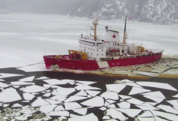A Canadian Coast Guard vessel plows through the ice on the St. Lawrence River to clear channels for commercial shipping. Photo: St. Lawrence Economic Development Council