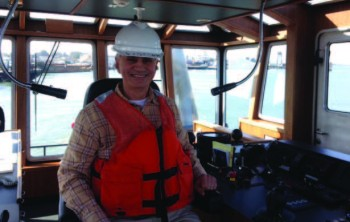 AJOT's Stas Margaronis aboard the tugboat, Ahbra Franco, at the Port of Oakland.