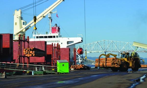 Logs loading at the Port of Longview, WA