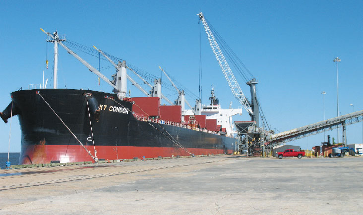 The bulk carrier KT Condor discharges ilmenite ore for DuPont at the Mississippi State Port Authority's Port of Gulfport.
