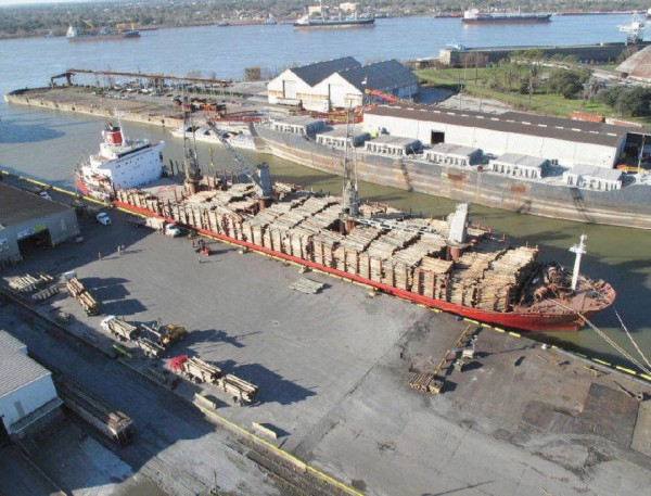 A log ship is loaded at a new facility of the St. Bernard Port, Harbor and Terminal District.
