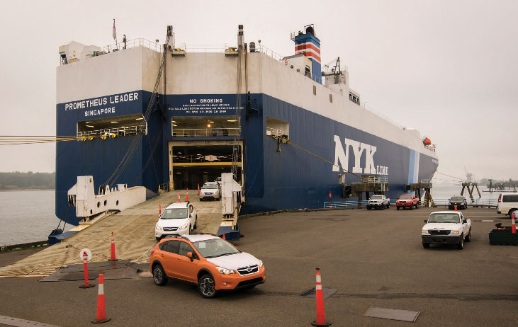 Subaru automobiles unloading at the Port of Vancouver USA.