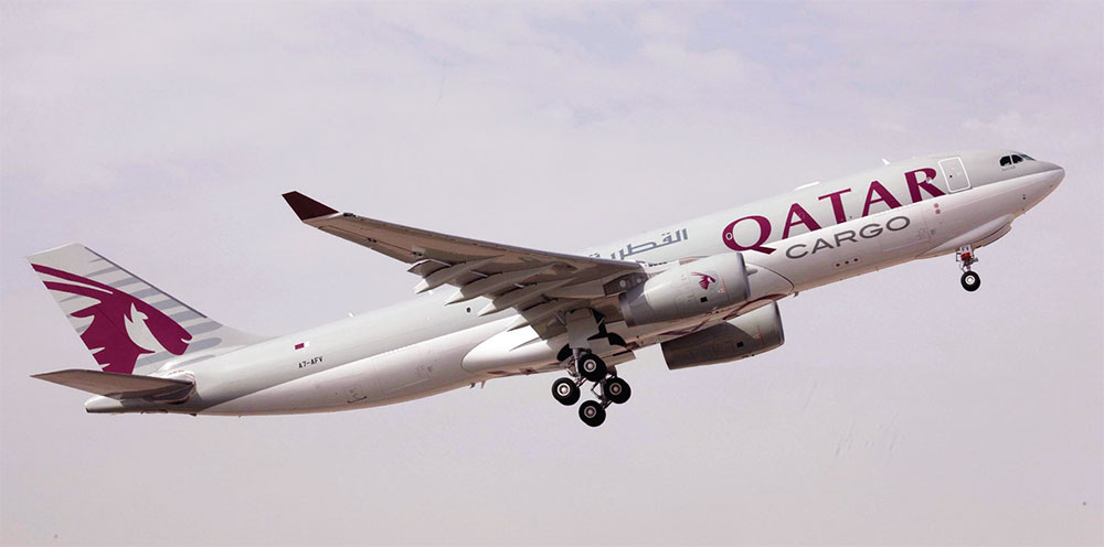 A Qatar Airways Cargo A330 freighter takes off from the runway.