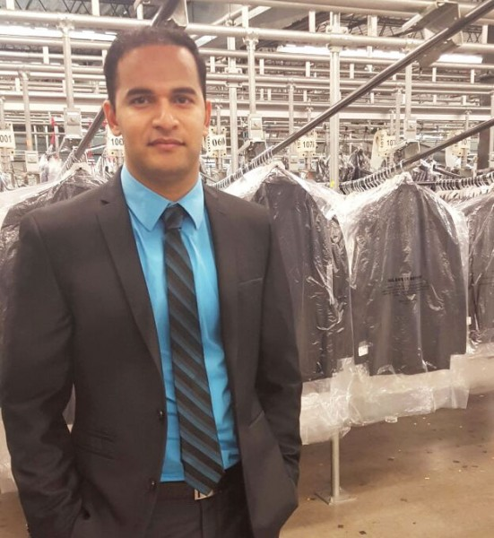 At The Men's Wearhouse Inc.'s 1.5 million-square-foot Houston distribution center, Tarun Methwani appears well-suited for his role as director of analysis and logistics support.