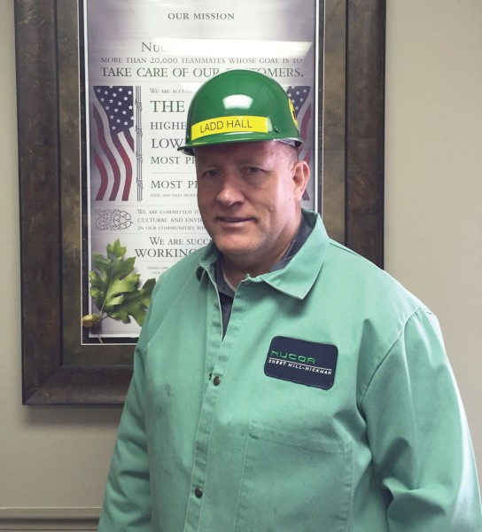 Ladd R. Hall, executive vice president of flat-rolled products at Nucor Corp., dons a hardhat before walking the floor at the Nucor Steel Arkansas sheet mill in Blytheville, Ark.