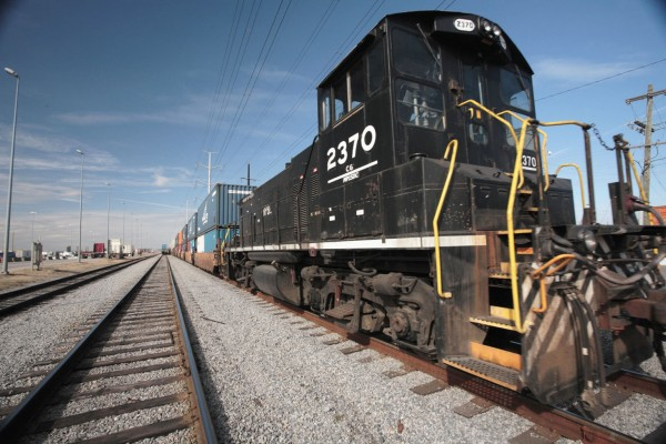 Trains with double-stacked containers move increasing volumes of cargo inland from the Port of Virginia's Norfolk International Terminals facility.