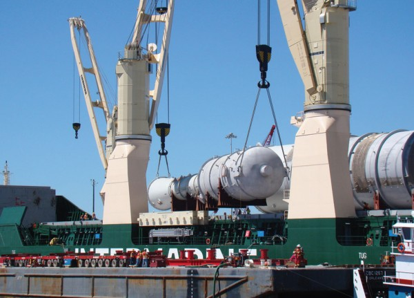 Indicative of heavylift cargo handled at Port Freeport for local plant construction projects, large pressure vessels are transferred from ship to barge