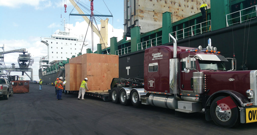 Oversized project cargo is discharged from a ship to a specialized truck trailer at the Port of Lake Charles in Southwest Louisiana