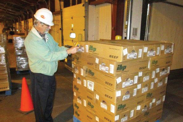 Tyson Food Inc.'s Perry Bourne uses an infrared device to verify the temperature of a chilled meat shipment to ensure it meets company quality assurance standards.