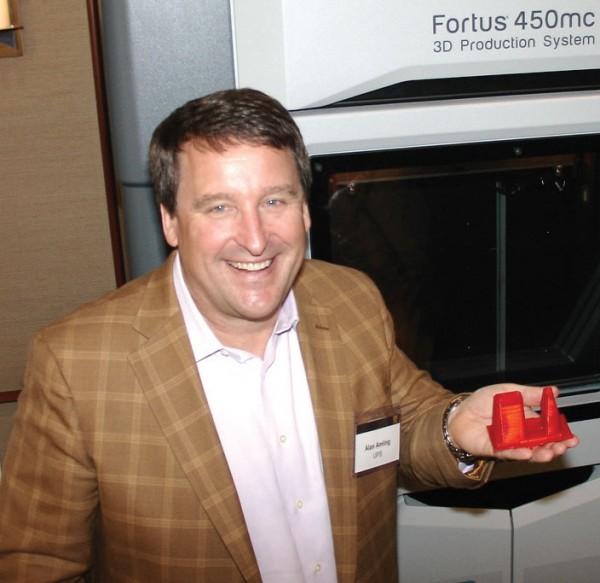 Alan Amling, UPS director of global logistics and distribution marketing, displays an ATM-card-accepting bezel. (Photo by Paul Scott Abbott, AJOT)
