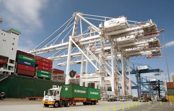 At the Port of Baltimore's Seagirt Marine Terminal, neo-Panamax cranes work Evergreen Marine Group's Ever Lambent at the 50-foot-deep container berth following the 8,452-TEU-capacity ship's July transit through the expanded Panama Canal.