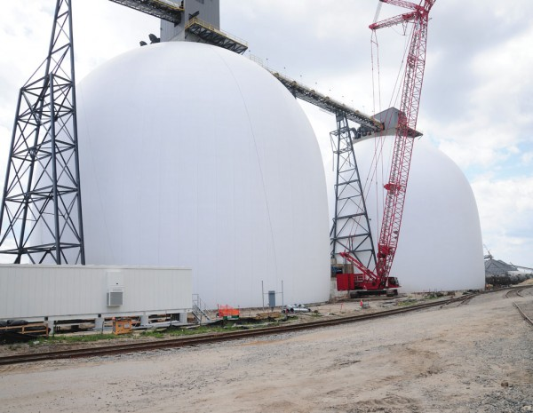 The two white domes will be able to receive, store and load export wood pellets.