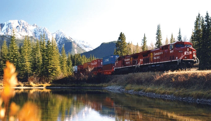 A Canadian Pacific Railway train speeds intermodal containers through the Canadian Rockies.