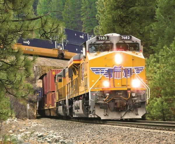 One Union Pacific Railroad intermodal train passes beneath another at a bridge in Northern California.