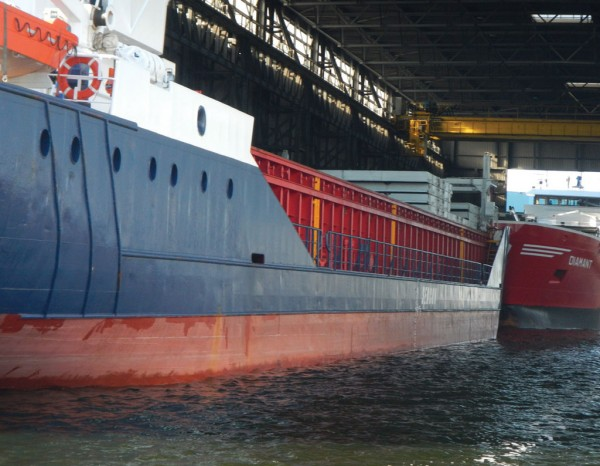 """The Waterland Terminal contains three all-weather berths in which vessels can pull into a """"roofed"""" terminal with a gantry-like crane arrangement in the ceiling to provide loading and unloading."""