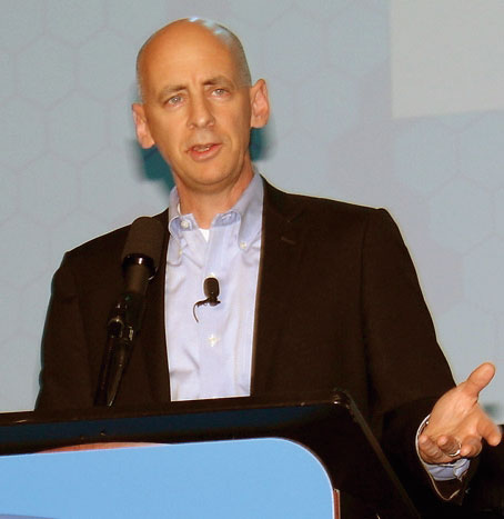 Barry Bramble, director of brokerage systems for UPS, says electronic U.S. Customs processes are helping the logistics industry get away from piles of paper. (Photo by Paul Scott Abbott, AJOT)