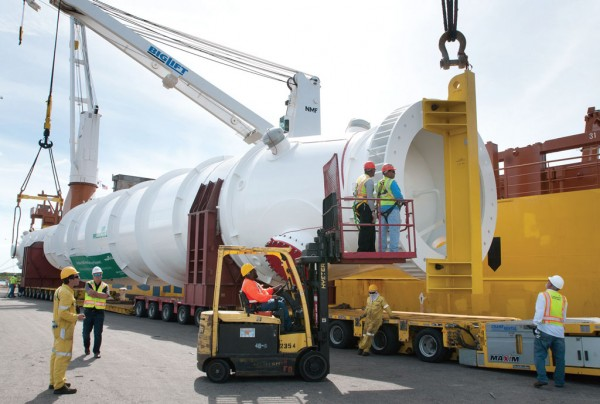 A huge Air Products liquefied natural gas heat exchanger, built across U.S. 41 from Port Manatee, is carefully loaded aboard a ship for export.