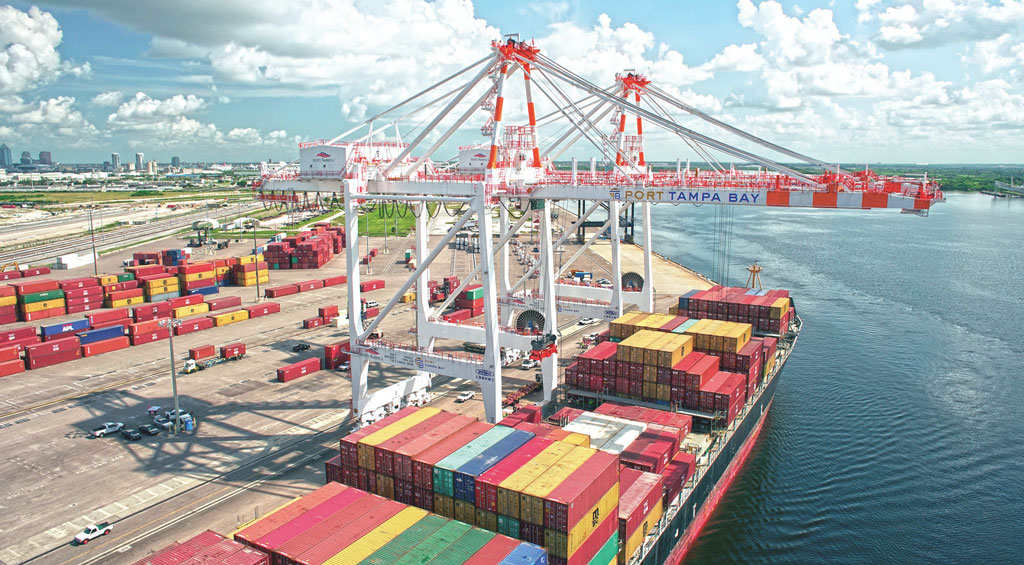 Two new post-Panamax cranes work a vessel at Port Tampa Bay's container terminal, which Ports America looks to operate through 2046.