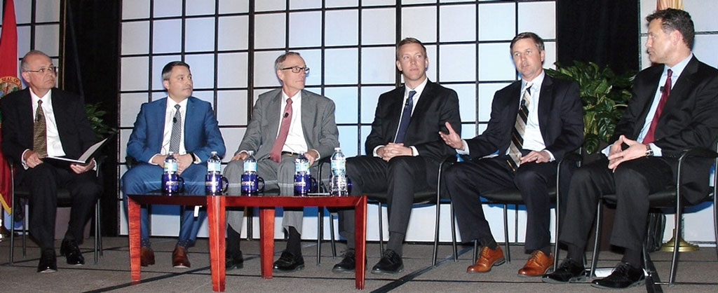 GP Cellulose LLC's supply chain director, Carter Noland, second from right, discusses shifting ocean carrier alliances with, from left, Jim Prior, divisional vice president for transportation, Coach Inc.; Fabio Santucci, president, Mediterranean Shipping Co. (USA) Inc.; Richard Craig, president and chief executive officer, MOL (America) Inc.; Charlie Cunnion, director of global transportation, International Forest Products LLC; and Mike Wilson, senior vice president for business operations, Hamburg Süd North America Inc. (Photo by Paul Scott Abbott, AJOT)