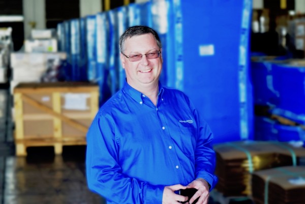 Aqua Gulf Transport President Sergio Sandrin has his iPhone in hand at the company's new warehouse in Jacksonville, Florida.