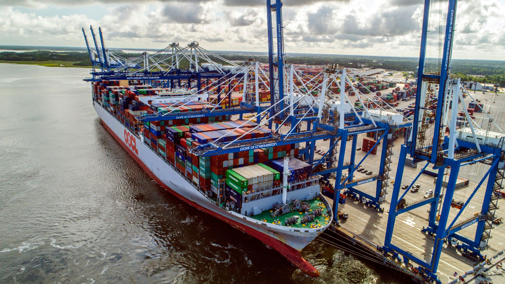 With a capacity of 13,208 TEUS, the OOCL France becomes the largest containership to call Charleston as it is worked June 5 at the Wando Welch Terminal. (Photo by SkyView Aerial Solutions)