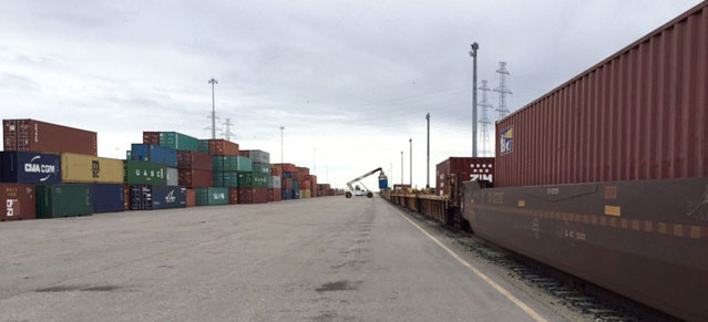 Container removal of a CN doublestack train at Calgary Logistics Park