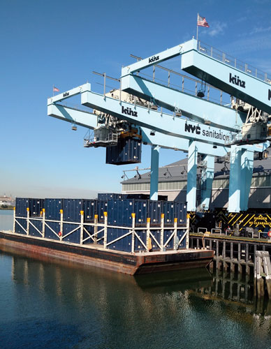 Kunz cranes work the barges, cycling containers on and off.