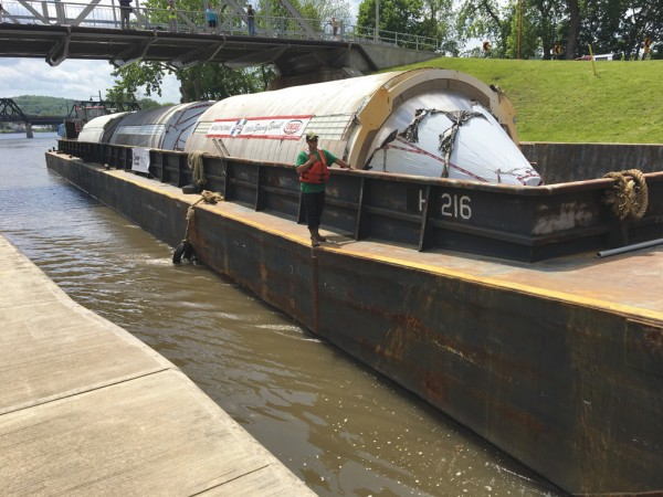 A barge passes through the Eric Canal in New York with brewery tanks for Genesee Brewery.