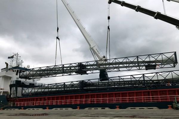 Cages containing a trio of 45-meter-long wind turbine blades from Spain are discharged at Delaware's Port of Wilmington, which has been enjoying strong project cargo activity.
