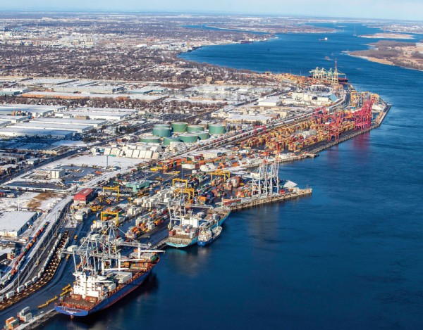 Aerial view of the bustling Port of Montreal targeting expanded container facilities.
