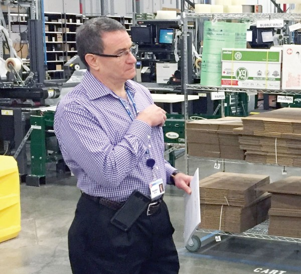Reuben Slone, senior vice president of supply chain management for Walgreens, observes supply chain practices on the floor of one of the drugstore chain's distribution centers.