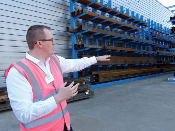 John Scott, a member of Combilift's marketing team, guiding a group of North American customers, dealers and journalists on a tour of the plant.