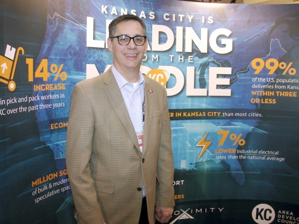 "At a recent trade show, Chris Gutierrez, president of KC SmartPort, extols the ""leading from the middle"" warehousing and distribution virtues of Kansas City. (Photo by Paul Scott Abbott, AJOT)"