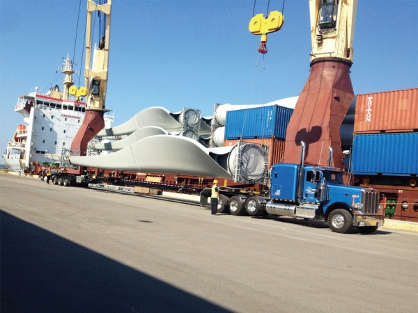 Direct unloading onto truck of windmill blades at Gros-Cacouna on St. Lawrence River. Photo credit: Express Mondor
