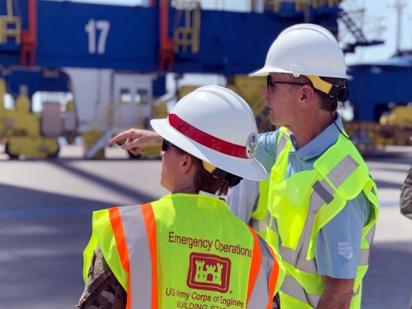 North Carolina State Ports Authority Executive Director Paul J. Cozza, right, discusses the Port of Wilmington's neo-Panamax crane contingent with Brig. Gen. Diana M. Holland, who commands the South Atlantic Division of the U.S. Army Corps of Engineers.