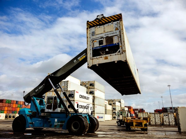 A toplift unloads a refrigerated container from a shuttle truck at North Carolina Ports' Port of Wilmington, where refrigerated container activity has tripled over the past three years.