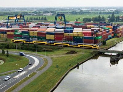 At Alpherium Container Terminal, which is 13 kilometers away from the Heineken brewery, the containers are stacked and loaded onto inland waterway vessels that sail by river to the container terminals at the Port of Rotterdam.
