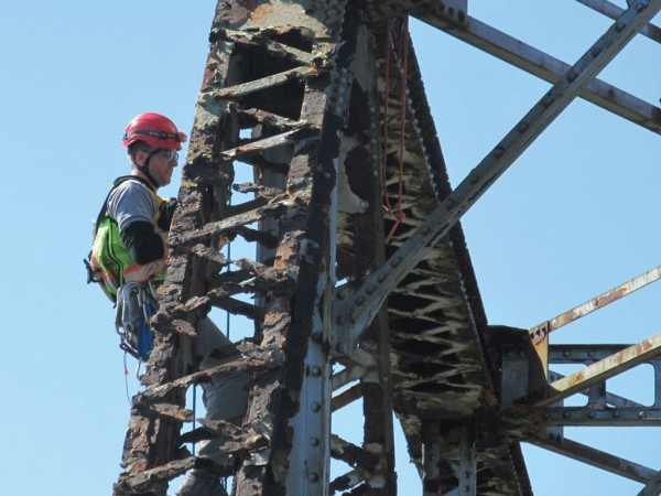 A civil engineer from Stantec inspects a bridge for the Oregon International Port of Coos Bay.