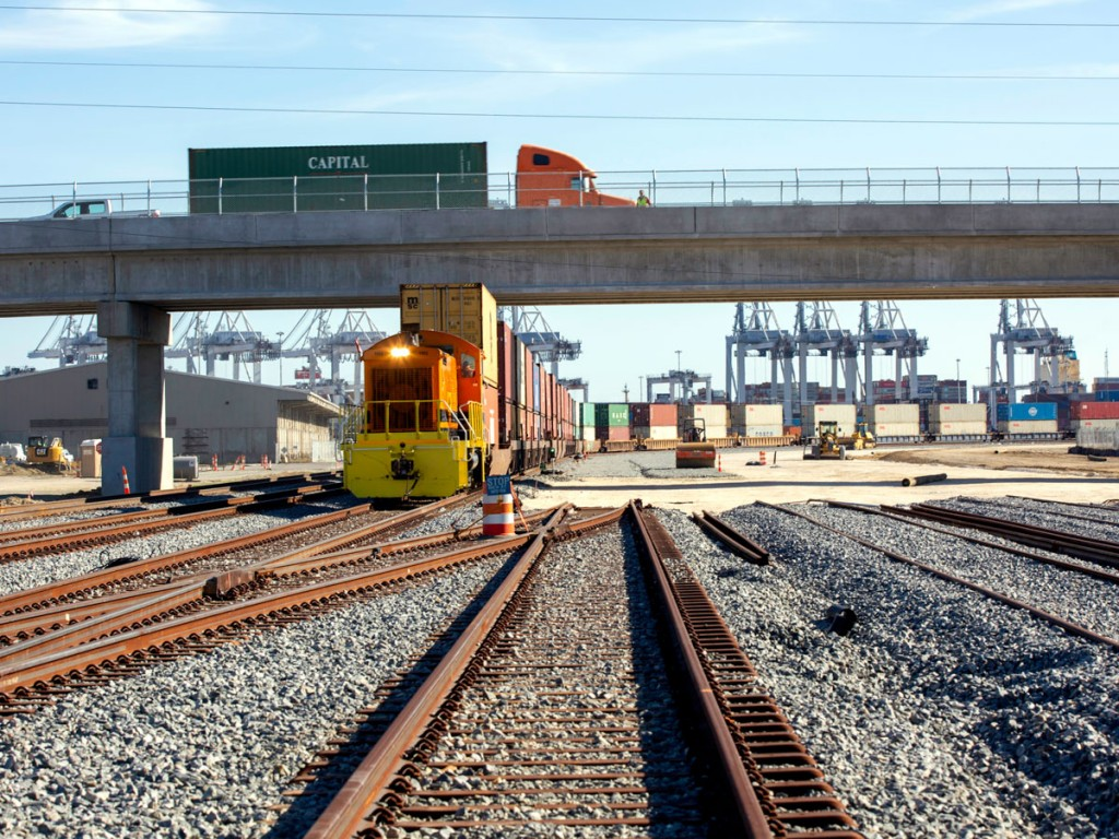 A train bound for America's Heartland passes under the Georgia State Route 25 overpass on newly installed track linking Port of Savannah rail yards of CSX and Norfolk Southern in forming the Mason Mega Rail Terminal. (Photo credit: Georgia Ports Authority/Emily Goldman)