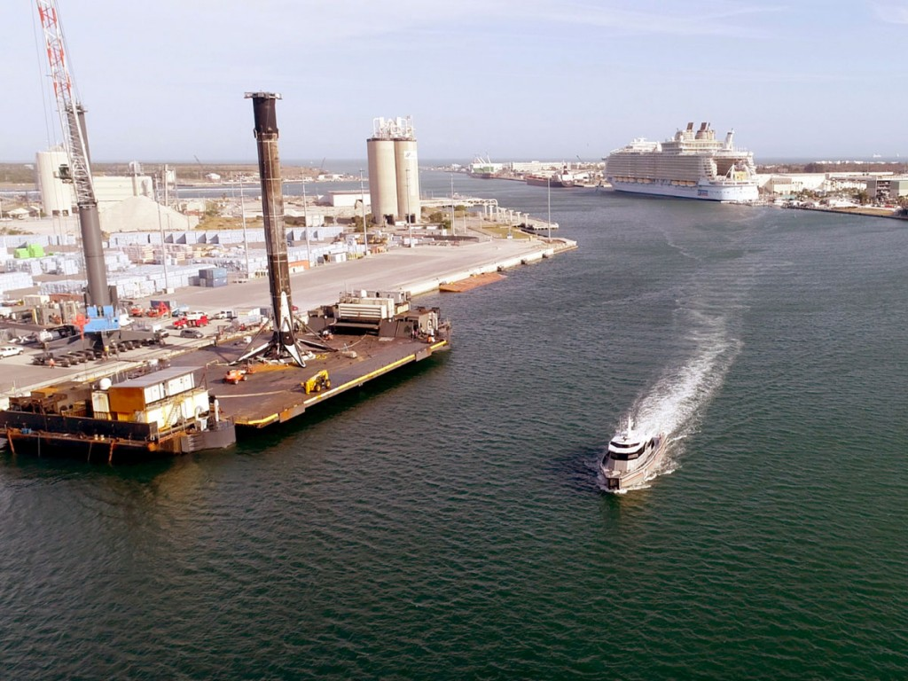 Diverse Port Canaveral sights includes a SpaceX booster to be lifted by the port's mobile crane, plus a new fireboat.