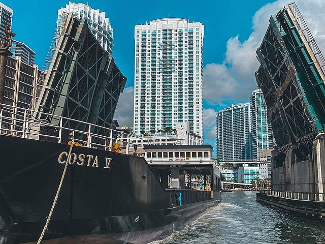 Centauri Transport's Costa V passes under a raised bascule bridge in serving shallow-draft Bahamian ports from a Miami River terminal.