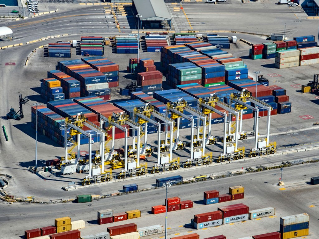 A new fleet of electrified rubber-tired gantries helps efficiently move containerized cargo through PortMiami's newly densified South Florida Container Terminal.