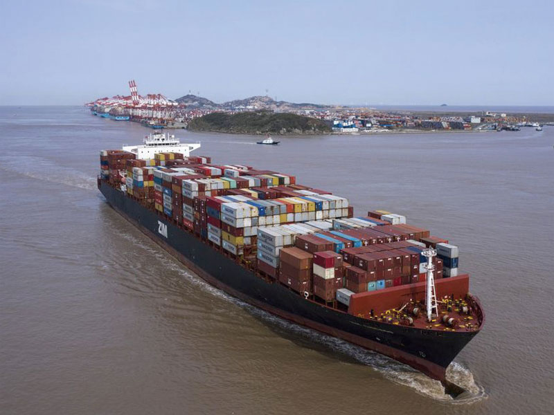 A container ship sails out of the Yangshan Deepwater Port in Shanghai, China.