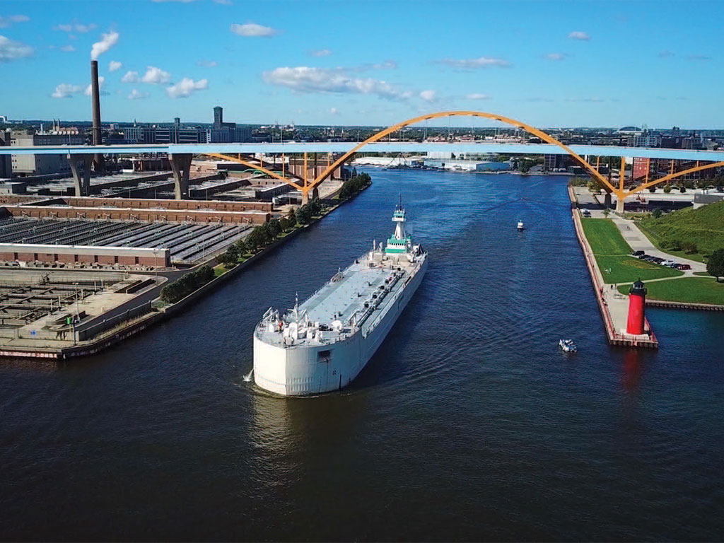 After depositing a load of cement at port tenant LafargeHolcim, a vessel departs Port Milwaukee, which is seeking development of an intermodal container facility.