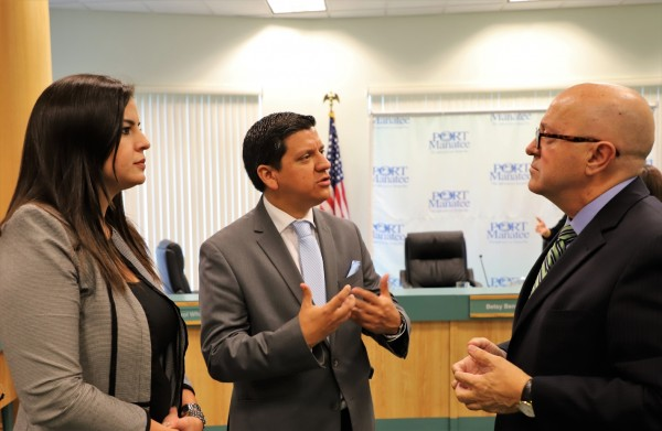 Discussing trade opportunities between Port Manatee and Ecuador are, from left: Daniela Muñoz, business development manager for Pro Ecuador; Manuel Echeverria Castro, Ecuador's trade commissioner for the southern United States; and Carlos Buqueras, executive director of Port Manatee.