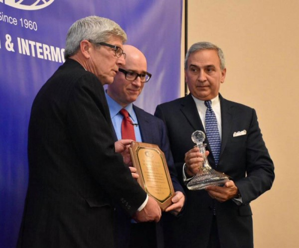 2017 Connie Award recipient, Brad Jacobs (center), CEO, XPO Logistics, is congratulated by Michael DiVirgilio (far left), President, CII, and Jim Newsome (far right), President and CEO of South Carolina State Ports Authority and previous Connie Award recipient.