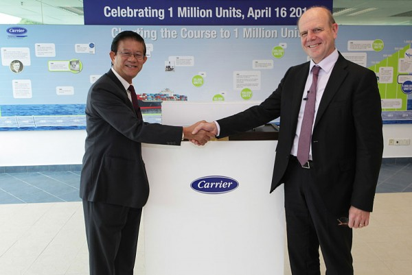Leaders from Carrier Transicold today presented its 1 millionth container refrigeration unit to representatives from CMA CGM, one of the world's largest container shipping companies, at the Carrier manufacturing plant in Singapore. Shown here, Chiou Fun Sin, president, Global Container Refrigeration, Carrier Transicold, left, and Alexis Michel, senior vice president, Container and Reefer Logistics, CMA CGM.